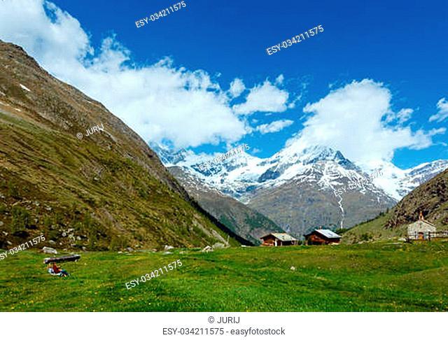 Family (mother with children) walk on summer Alps mountain plateau (Switzerland, near Zermatt)
