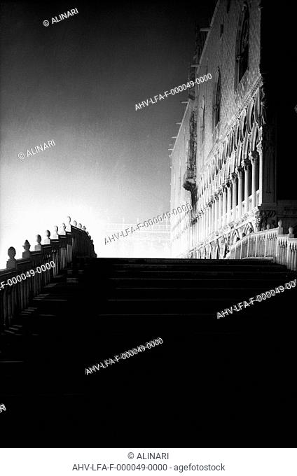 The Ponte della Paglia in Venice dominated by the facade of Palazzo Ducale (1360), shot 1956 by Leiss Ferruccio