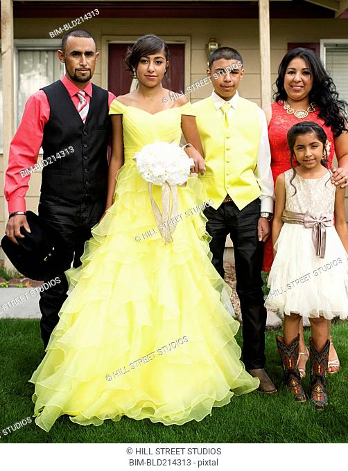 Hispanic family celebrating quinceanera