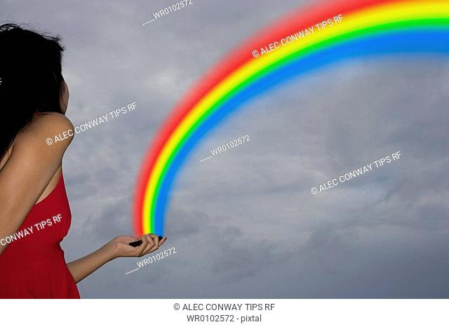 Maldives, South Male Atoll, asian woman with rainbow