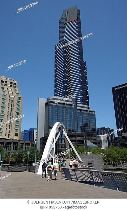 Southbank, pedestrian bridge across Yarra River and Eureka Tower, Melbourne, Victoria, Australia