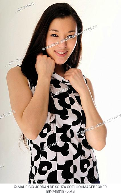 Fashionable East Asian girl raising her fists (cutout)