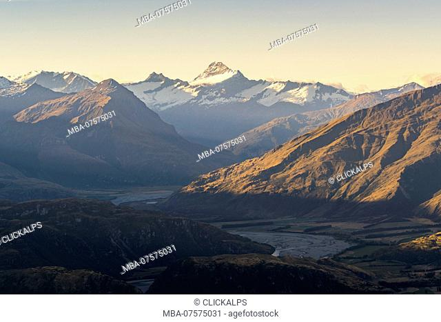 Last rays of light on Mt Aspiring seen from Roys Peak lookout, Wanaka, Queenstown Lakes district, Otago region, South Island, New Zealand