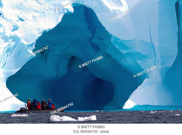 Boat and iceberg, ice floe in the Southern Ocean, 180 miles north of East Antarctica, Antarctica
