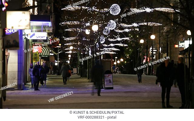 Christmas decorations are glittering in the pedestrian zone in the Swedish city Sundsvall at Christmas time. Time lapse., Västernorrlands Län, Sweden