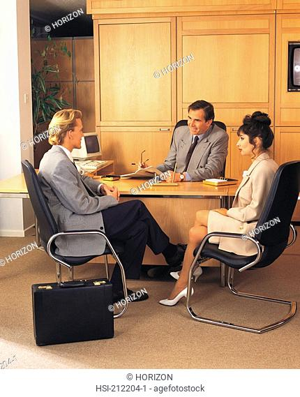 Businesspeople discussing together in a meeting