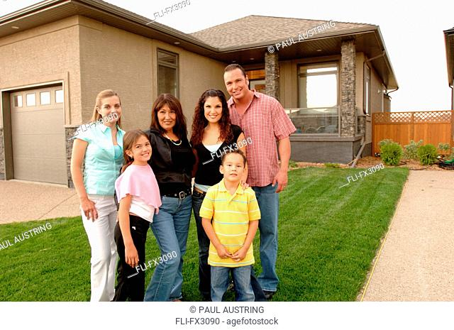 Family Standing on Lawn