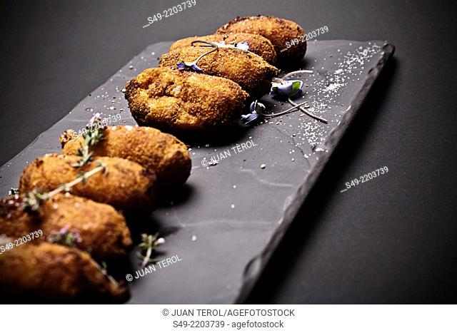 Croquettes on stone tray