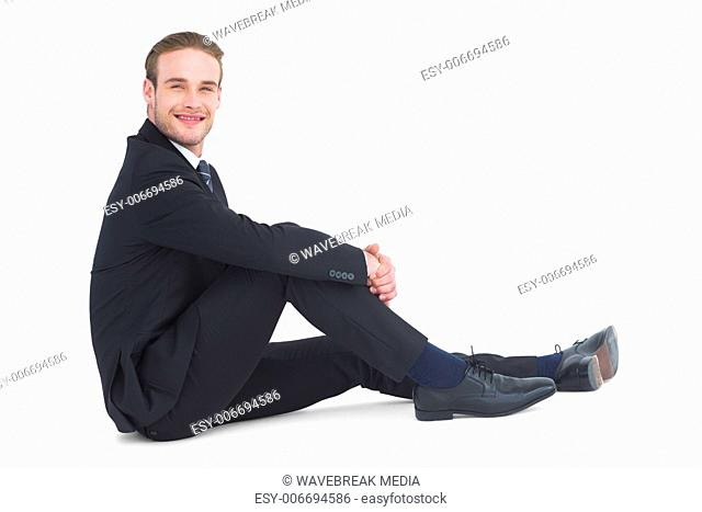 Relaxed businessman sitting and smiling