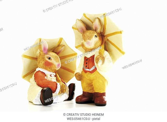 Easter bunnies holding umbrella