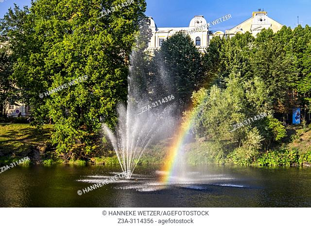Rainbow in th fountain next to the National Opera in Riga, Latvia, Europe