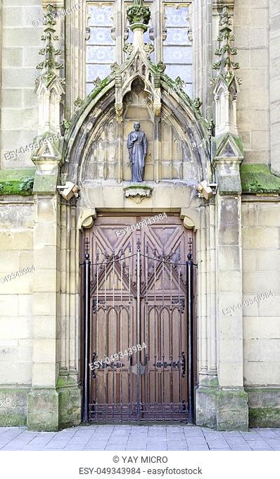 Gothic church door, detail of a religious and historical, art and religion building