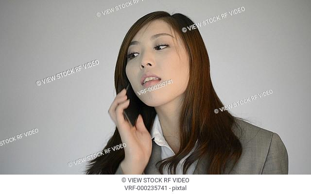 video of woman calling by telephone