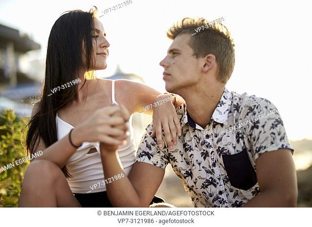 Sensual couple holding hands, relationship, dating, love. Chersonissos, Crete, Greece