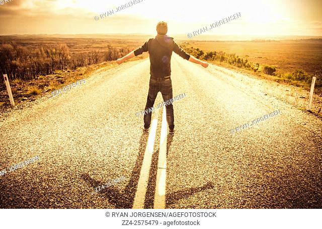 Chance concept of a man taking a balanced risk while facing fears on the road of life. Change ahead