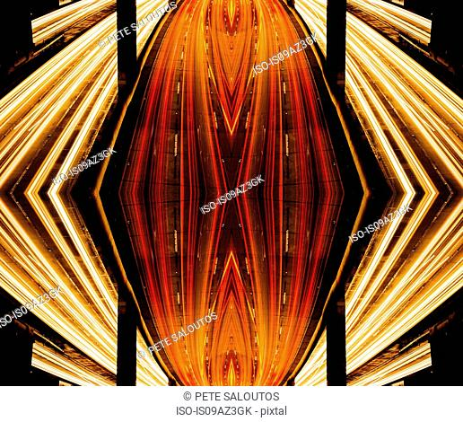 Abstract mirror image of highway traffic and light trails at night