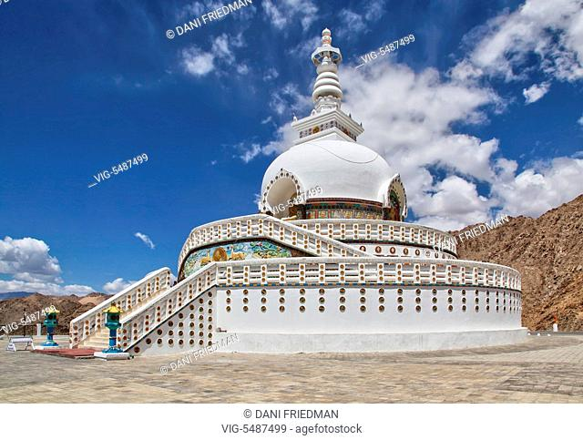 The Shanti Stupa rests on a mountaintop in Changspa, Ladakh, India. Conical in shape the stupa has several levels each accessible by stairways