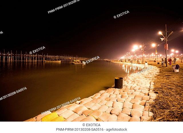 Bank of Ganges River lit up at night at Maha Kumbh, Allahabad, Uttar Pradesh, India