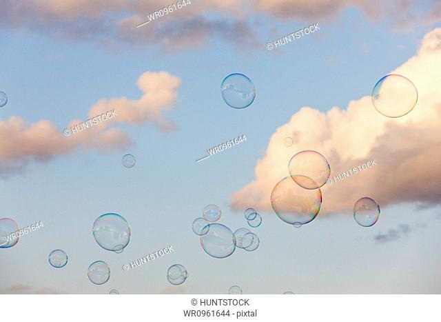 Bubbles floating through the air with clouds in the background, Fan Pier, Inner Harbor, Boston Harbor, Boston, Massachusetts, USA