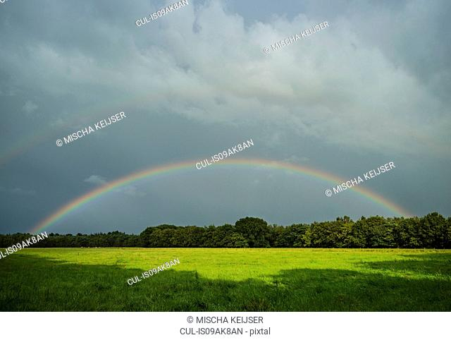 Storm clouds and rainbow over field landscape, Breda, Noord-Brabant, the Netherlands