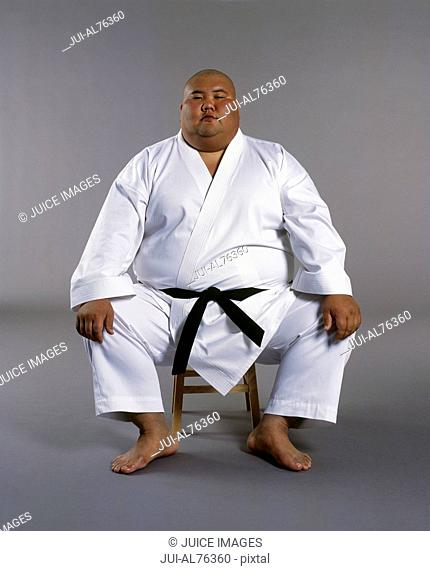 Portrait of a martial arts student sitting on a stool