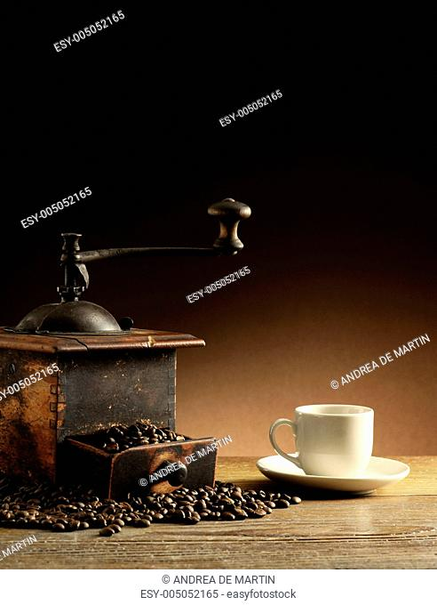grinder and coffee cup
