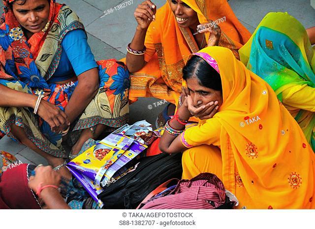 Pilgrim women at Har Ki Pairi ghat by the Ganges river