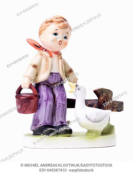 Very old statue, small ceramic boy with a goose, isolated on white