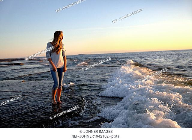 Teenage girl on beach at evening, Oland, Sweden