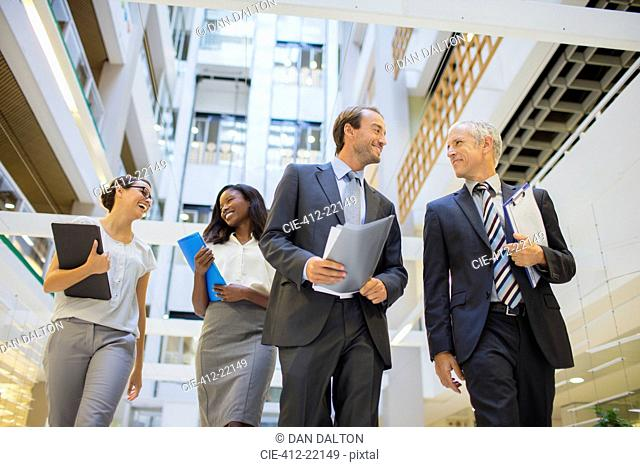 Business people walking together in office building