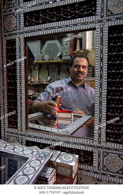 Artisan Nabil El Tablawy with his products in mother of pearl, Khan Al Khalili Bazaar, , Cairo, Egypt, North Africa, Africa