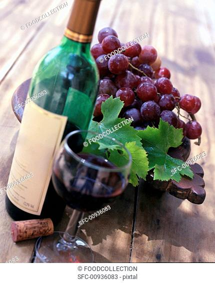 Still life with red wine and red wine grapes