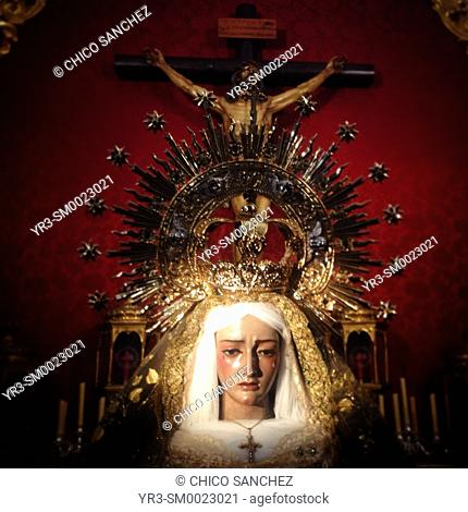 The images of the Virgin Mary and Jesus Christ crucified are displayed during Easter Holy Week in an altar in Prado del Rey, Sierra de Cadiz, Andalusia, Spain