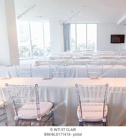 Empty tables in conference room
