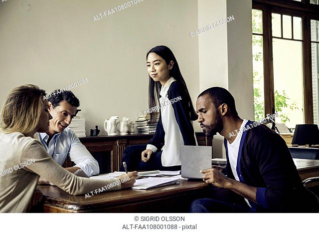Colleagues working together in casual office