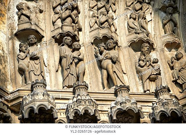 "Medieval Gothic Sculptures of the South portal of the Cathedral of Chartres, France. The portal shaows the Last Judgement and the small figures represent """"The..."