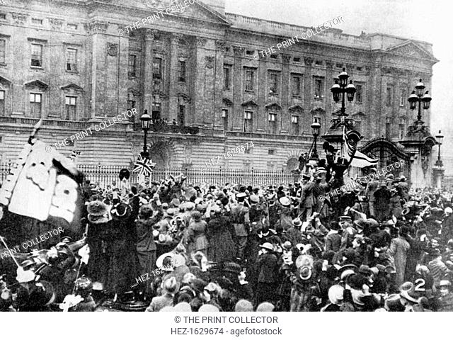 The official notice of the armistice being read, Buckingham Palace, 1918 (1936). From His Majesty the King, 1910-1935, introduction by HW Wilson (Associated...