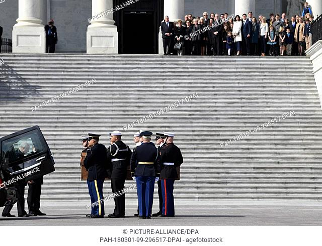 The family of Rev. Billy Graham watches as the casket of Rev. Billy Graham arrives at the U.S. Capitol in Washington, Wednesday, Feb