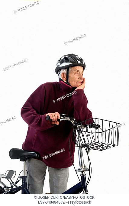 Elderly woman on a bicycle on a white background