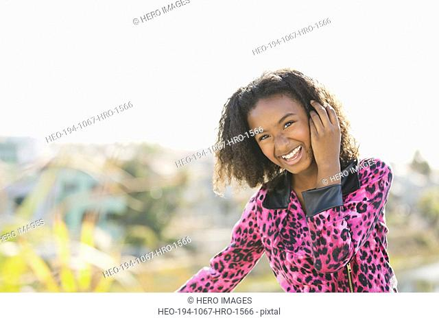 Portrait of smiling girl outdoors