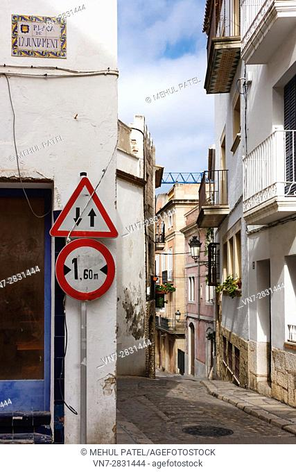 Narrow street in the old town of Sitges by the town hall square, Catalonia, Spain, Europe