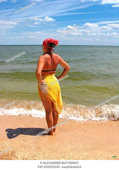The girl standing at the seacoast