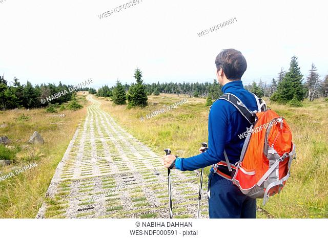 Germany, Harz, Brocken, hiker with backpack and hiking poles