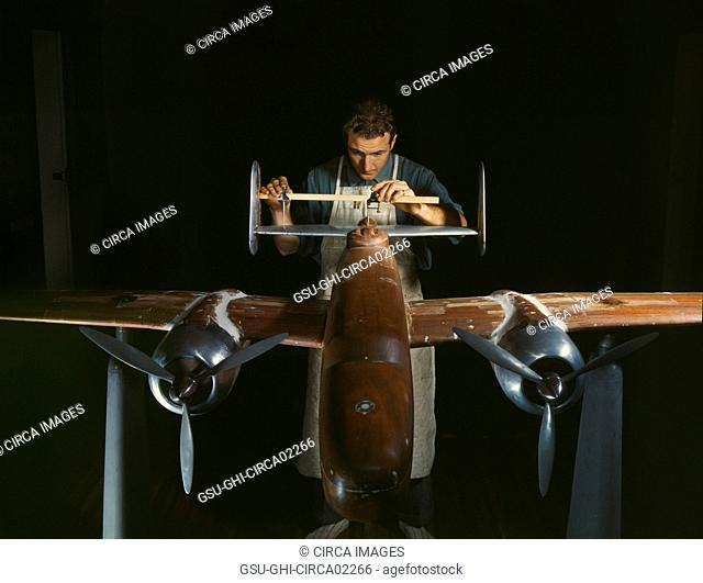 Worker Preparing Experimental Scale Model of B-25 Airplane for Wind Tunnel Tests, North American Aviation Plant, Inglewood, California, USA, Alfred T