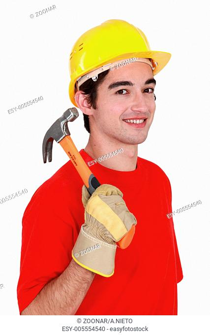 Young workman with a hammer