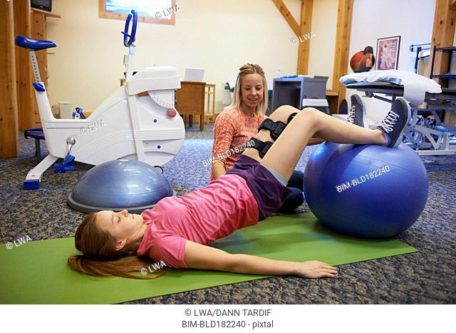 Caucasian girl having physical therapy
