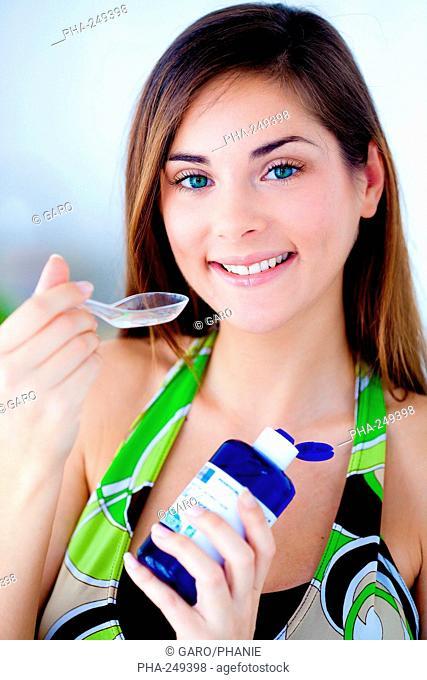 Woman drinking flower water
