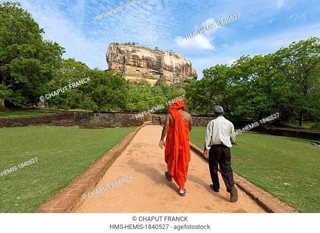 Sri Lanka, Central province, Matale district, Sigiriya, Old city listed as World Heritage by UNESCO, Rock of the Lion, mens walking on a path in the middle of a...