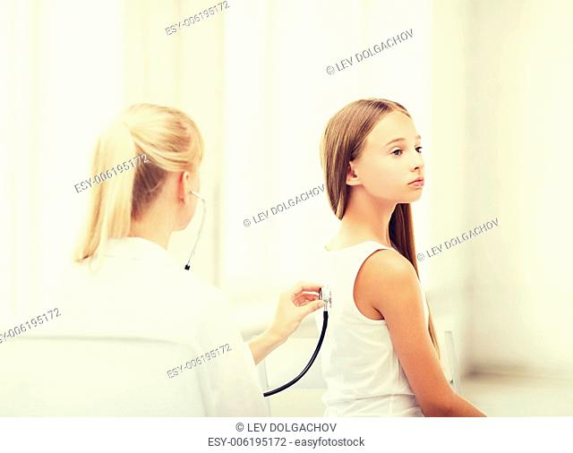 healthcare and medical - doctor with stethoscope listening to child back in hospital