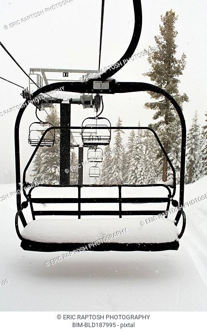 Empty ski lift on snowy mountainside